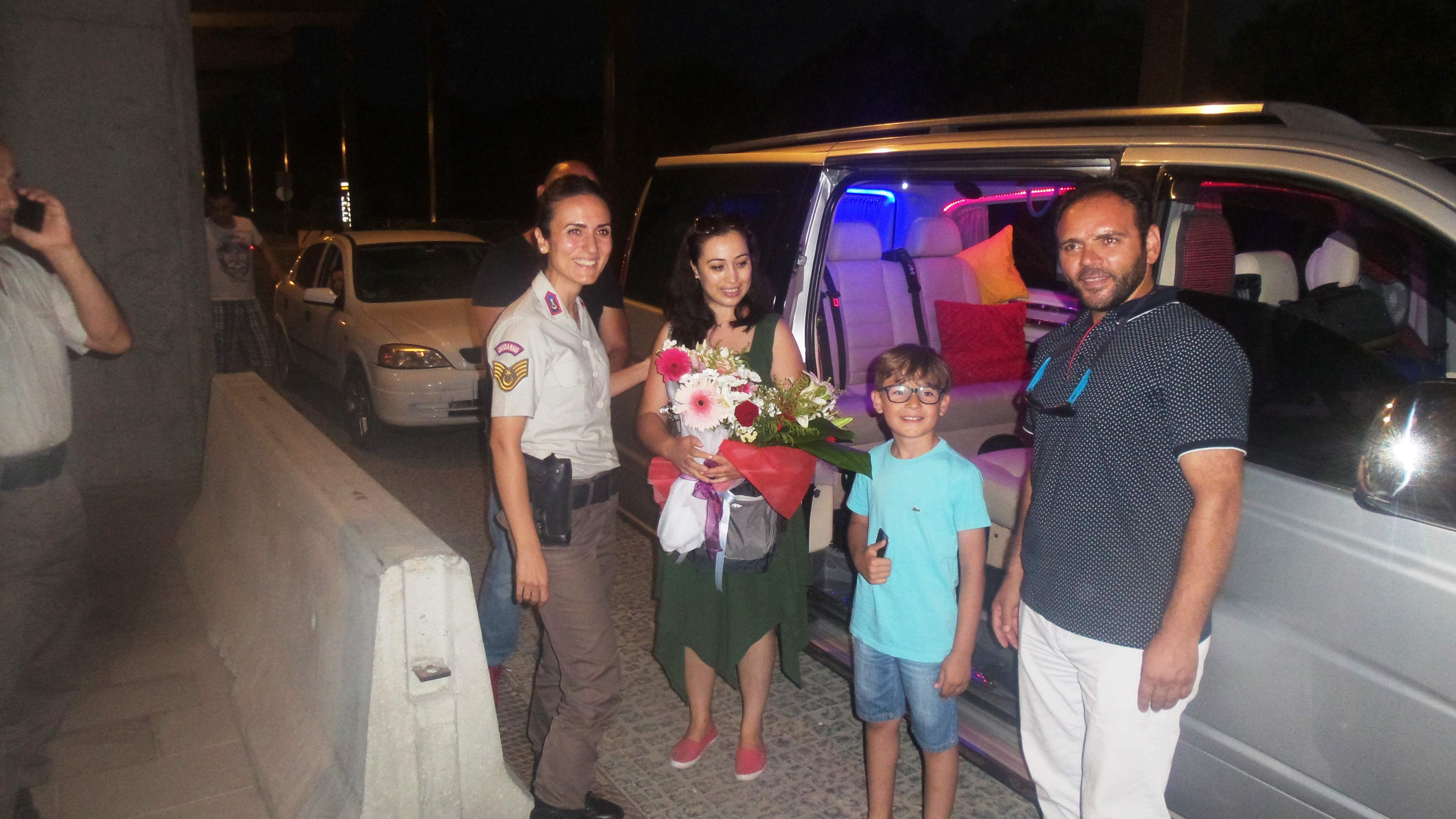Bakan Fikri Işık'ın makam aracını tahsis ettiği şehit oğlu ve eşi Dalaman'a geldi